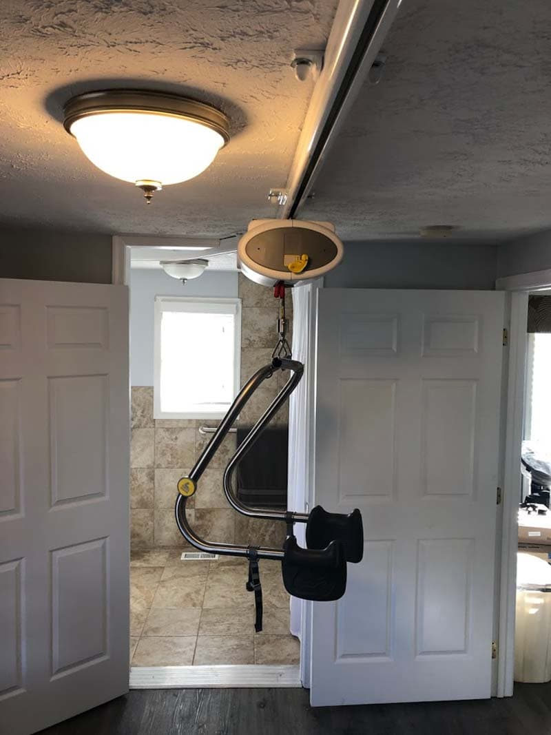 doorway to remodeled bathroom with an overhead lift