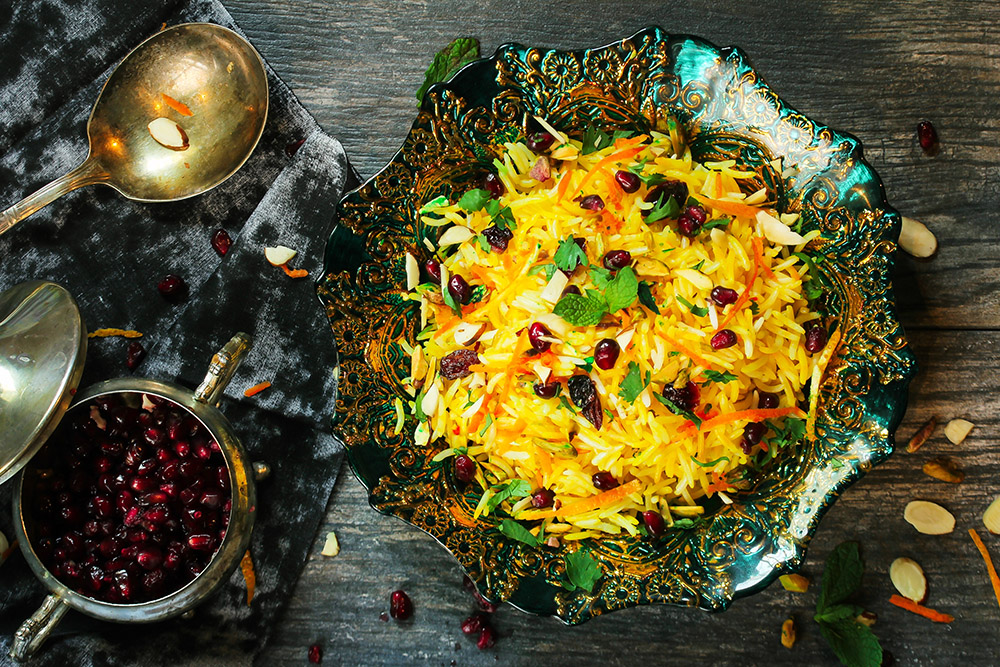 rice with pomegranate seeds in ornate bowl