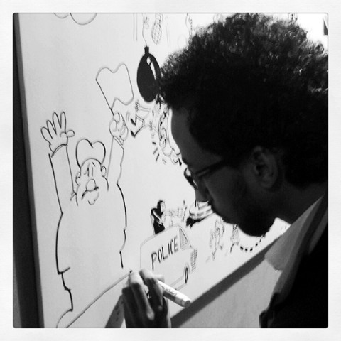 Anwar participates in a cartoon anti-government draw-off in a downtown Cairo square, January 2013. Photo by the author