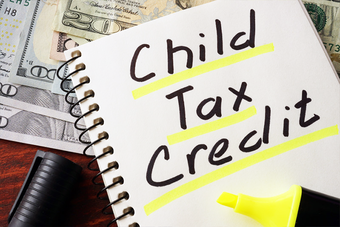 Tax credit written on a notepad and highlighted