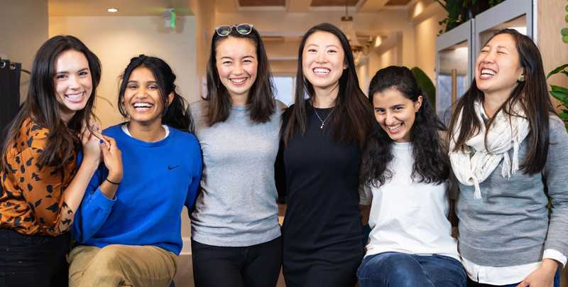 Women of Culdesac: Vanessa, Lava, Dilly, Kristy, Lama, Jen smiling for camera at SF office