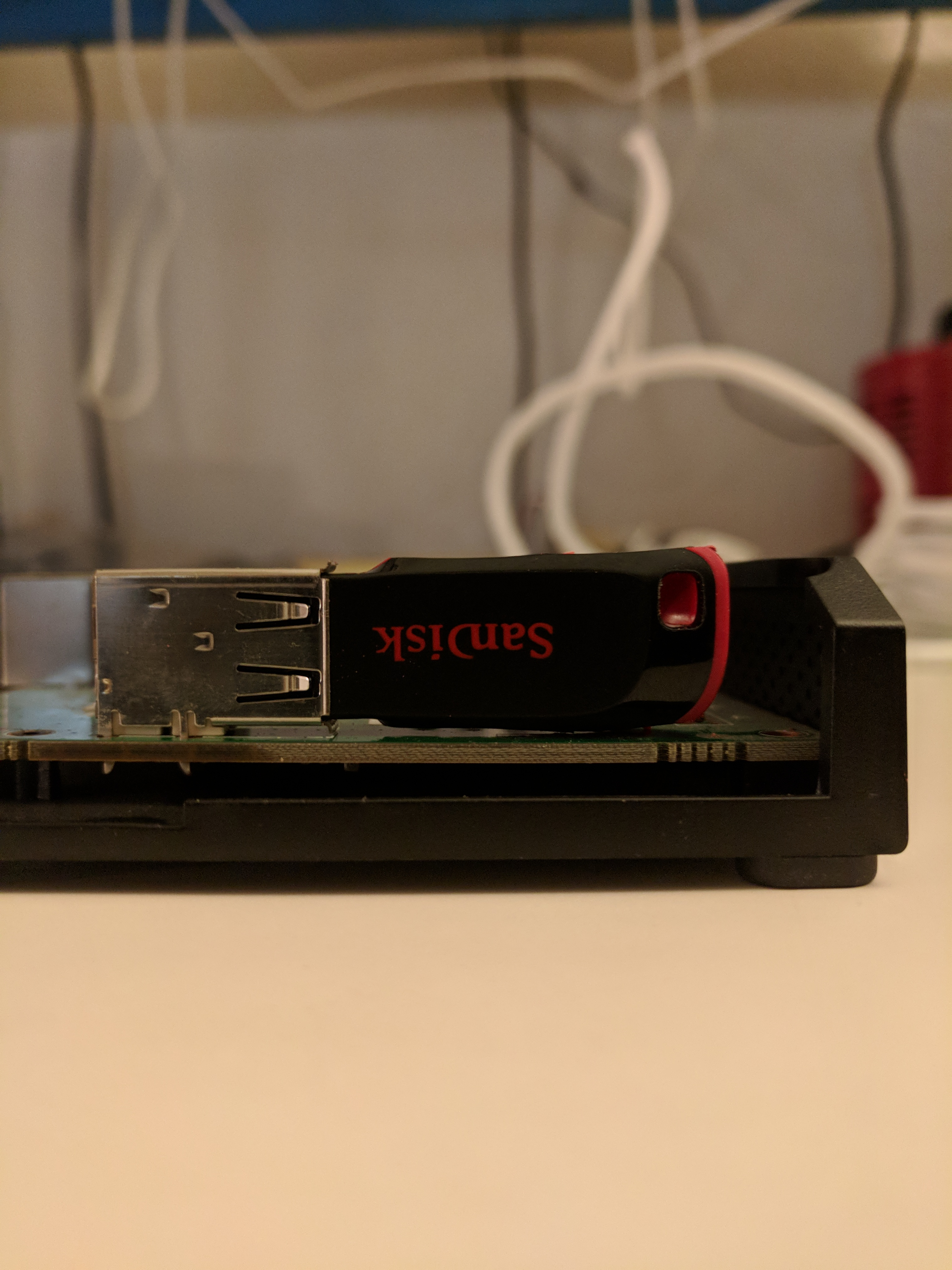 Sandisk Cruzer Blade 8GB USB thumb drive with case ground down installed in Ubiquity EdgeRouter Lite.  The thumb drive barely fits vertically in the EdgeRouter case.