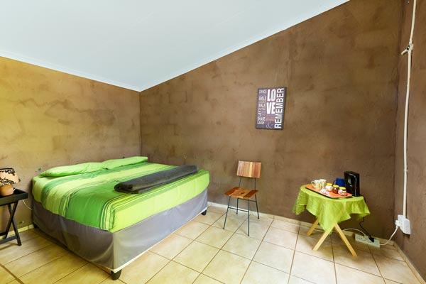 Inside view of a double bed en-suite room.