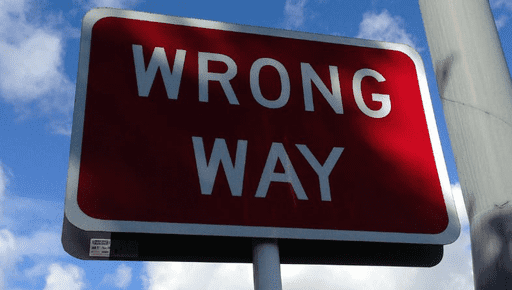 Big red warning road sign for wrong way with blue sky in the background #business