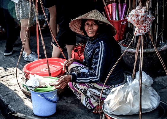 A lady selling at the market