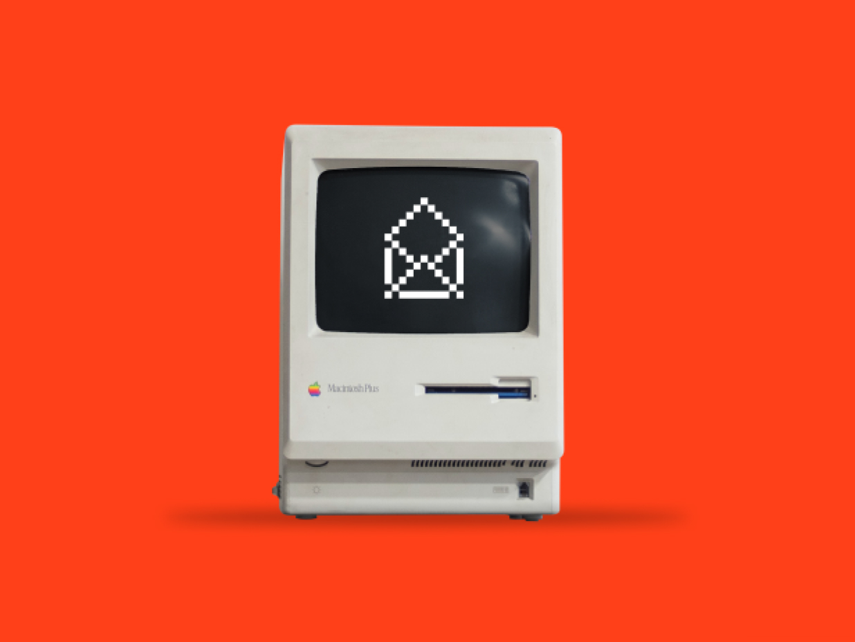 Old Apple computer with a pixalated open mail envelope.