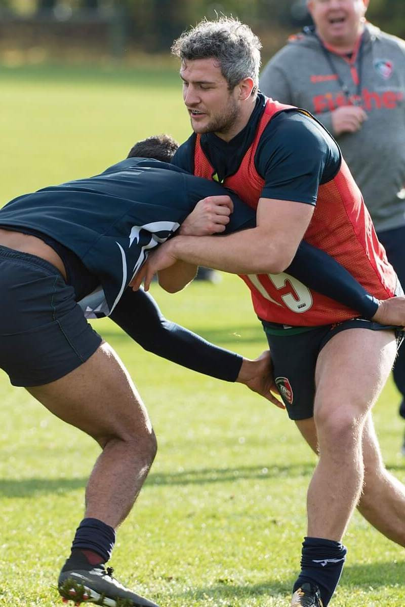 Two men rugby tackle
