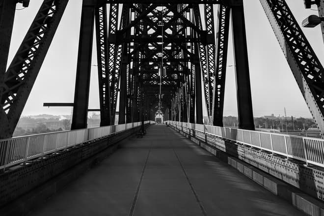 Looking south towards Kentucky along a steel footbridge crossing the Ohio River.