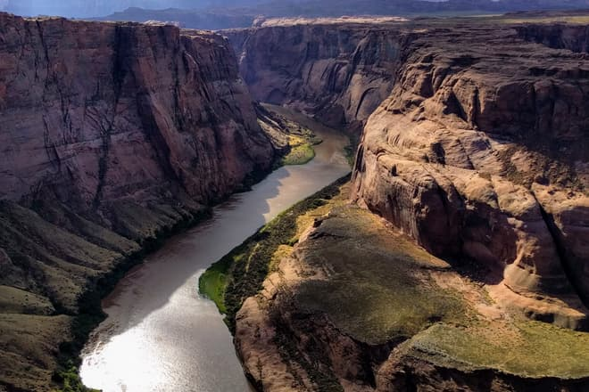 A detail of the south side of the Colorado River as it rounds Horseshoe Bend.