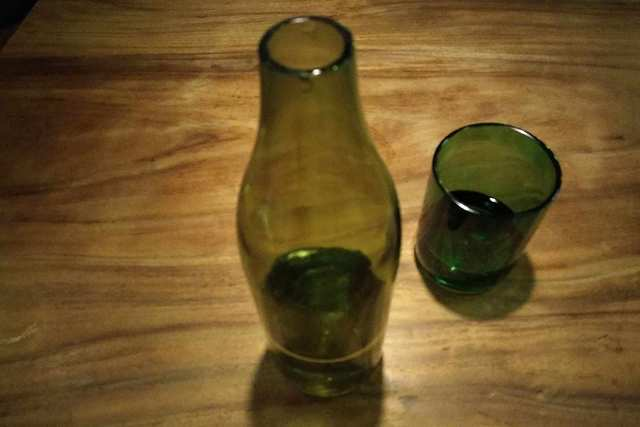 Up-cycled Glass - Use recycled glass and bottles to make lamp and serve water to customers.