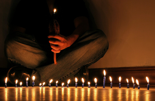 man lighting candles