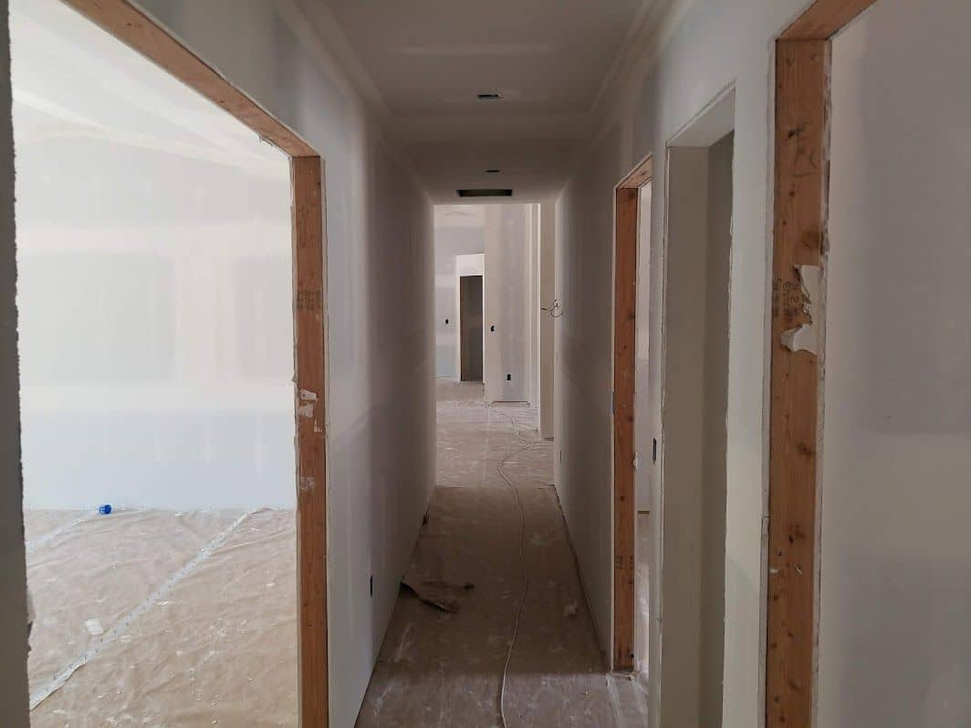 enlarged photo of newly installed and finished drywall installation befre painting is applied