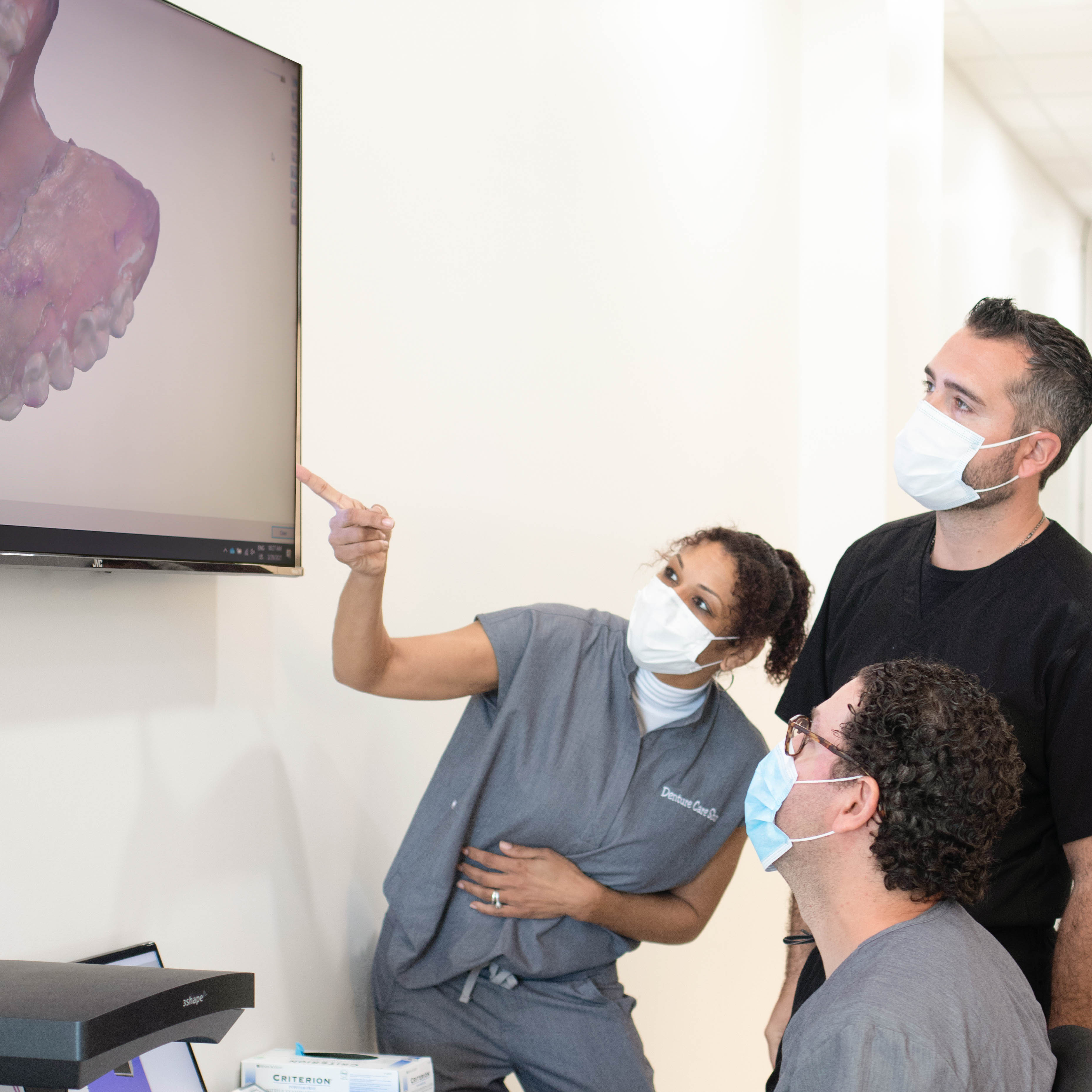 Step 2:  Dental assistant scanning immediate or permanent dentures with 3D dental technology to create affordable, same day dentures. The patient chooses either dentures refit or replica false teeth replacements.