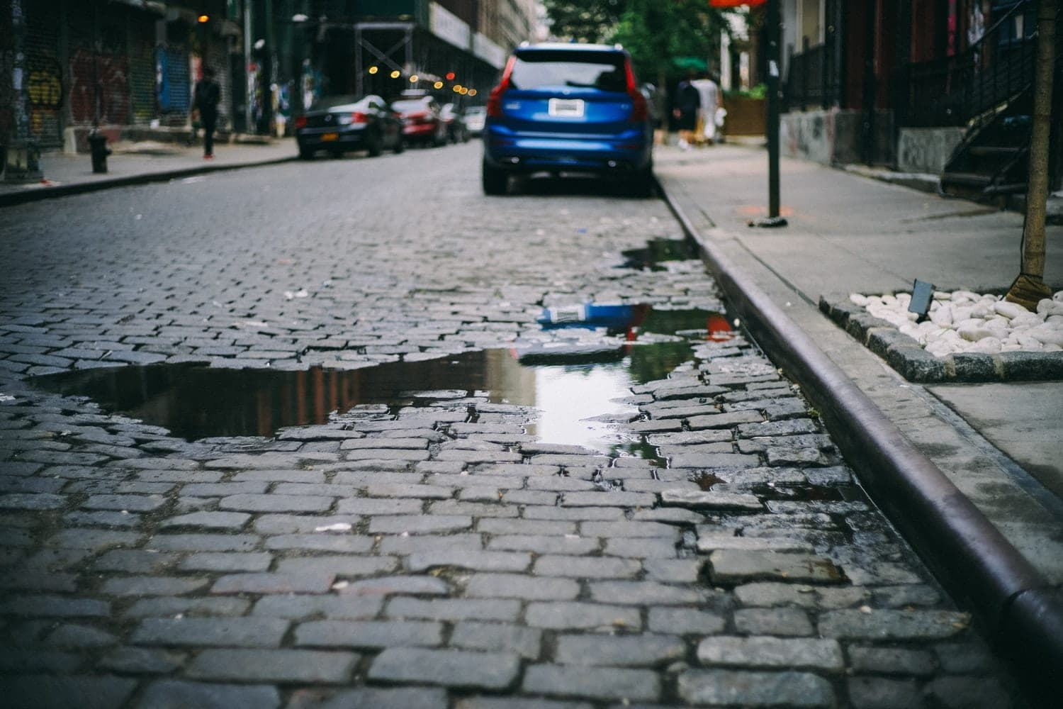 A pothole on a cobblestone road