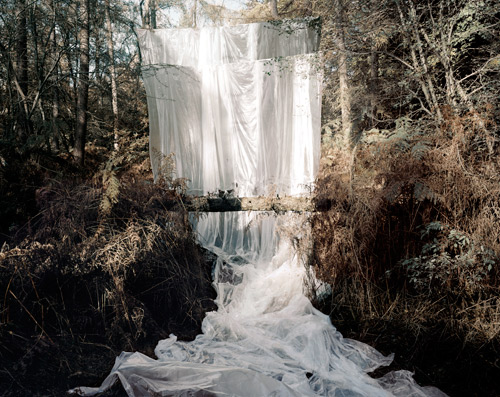Noemie Goudal.Les Amants (Cascade), 2009. The shifting space between reality and fantasy, nature and intervention, playfulness and tragedy, is where Noemie Goudal's fantastical images live.For More Visit: {www.noemiegoudal.com}