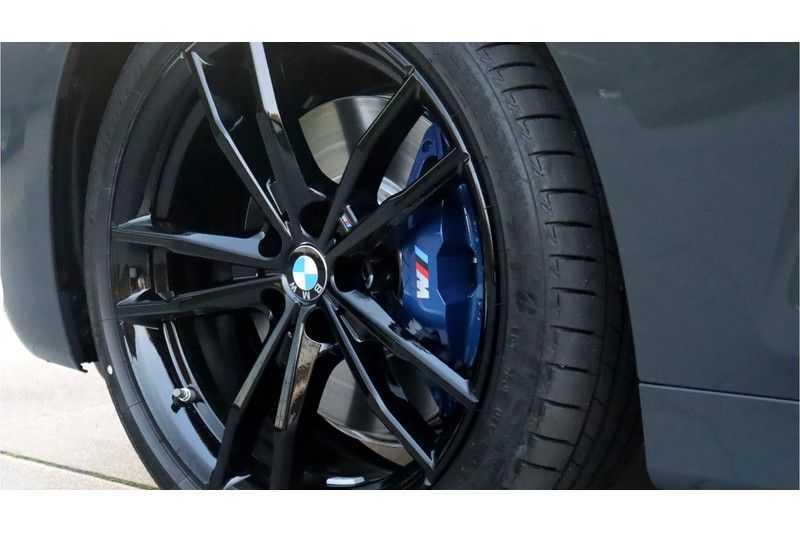 BMW 4 Serie Coupé M440i xDrive High Executive Harman/Kardon, Head Up Display, Schuifdak afbeelding 11