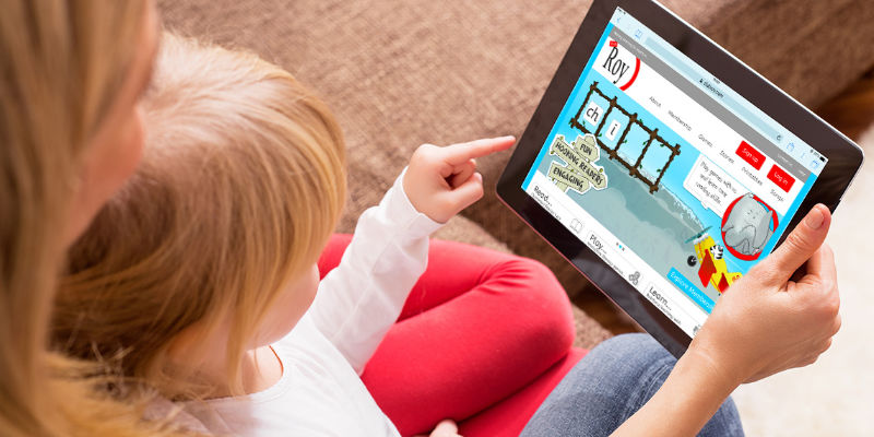 Image of child playing tablet