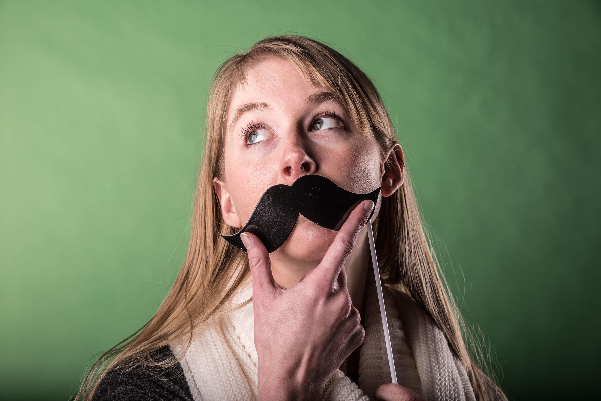 Portrait of woman wearing mustache