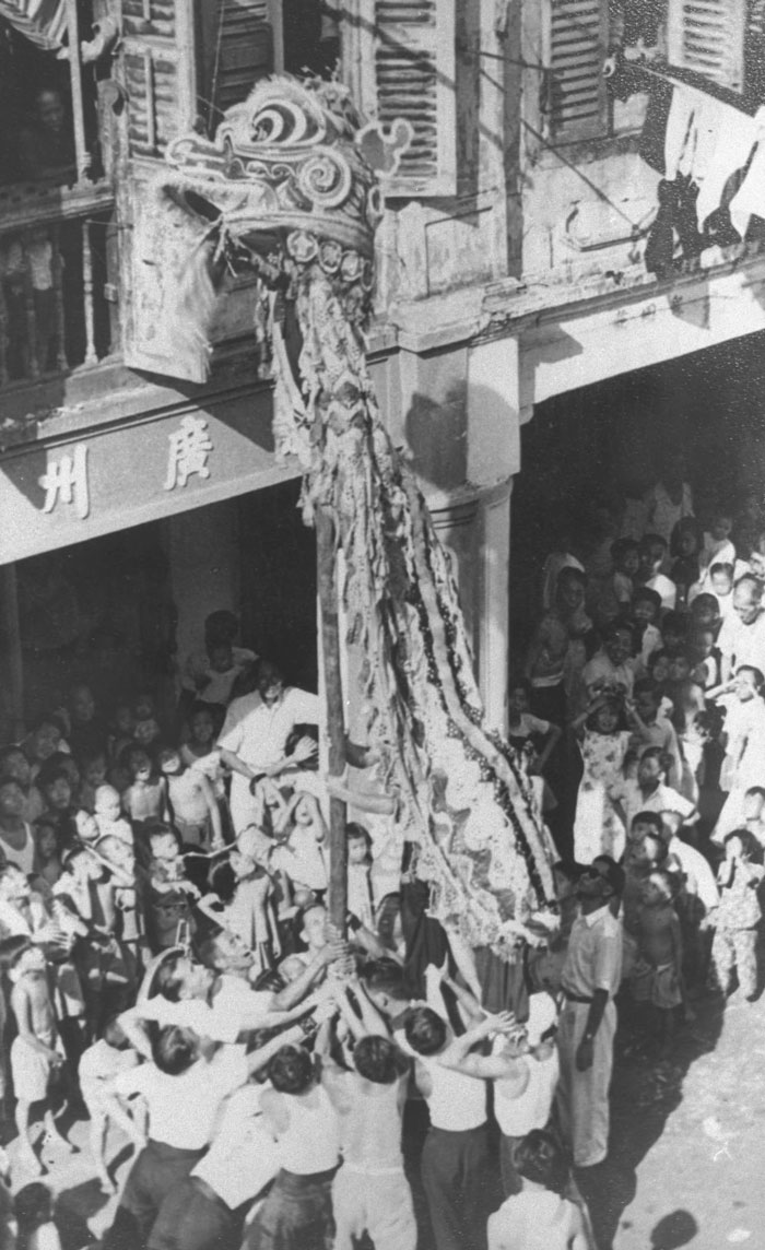 Lion dance on Smith Street, Chinatown, 1951