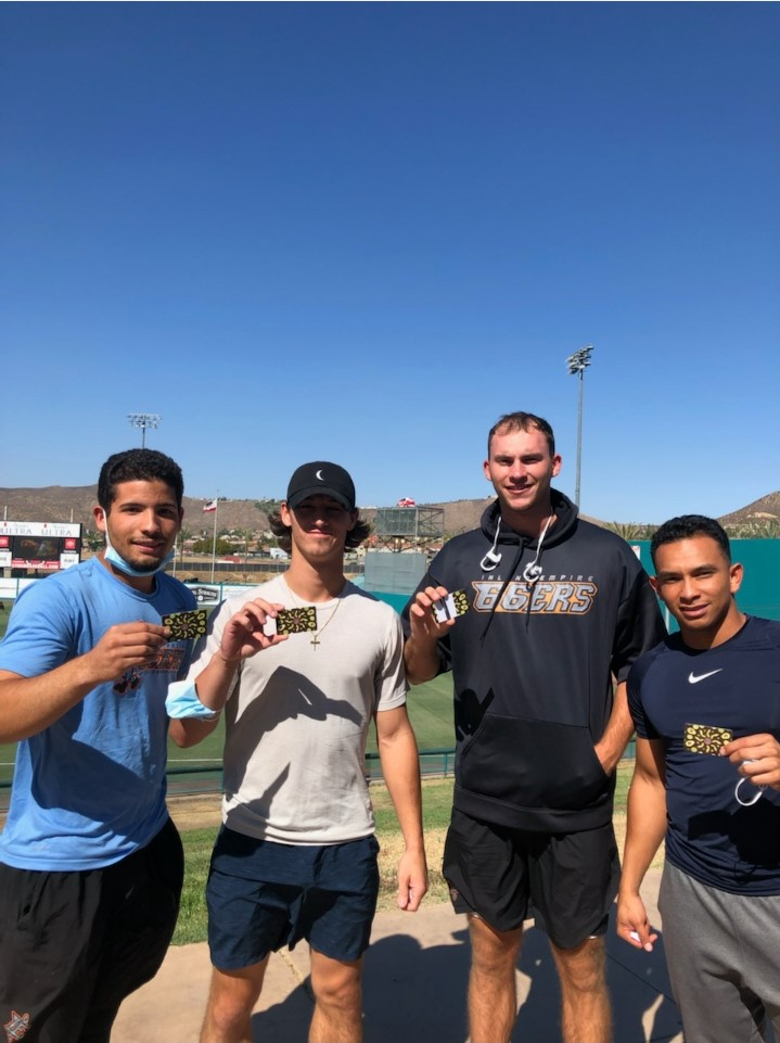 66ers player with Chipotle gift cards.