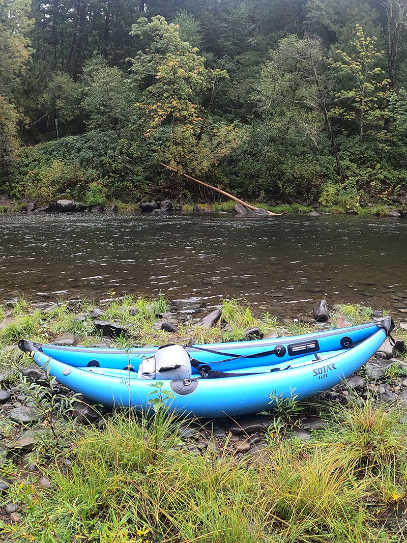 Fording a river with a blow up kayak to reach hidden Washington hot springs