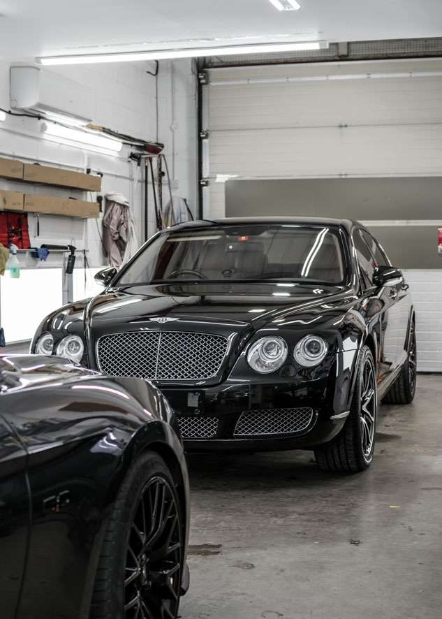 Shiny Bentley Flying Spur car after polishing, paint correction, paint enhancement and headlight restoration