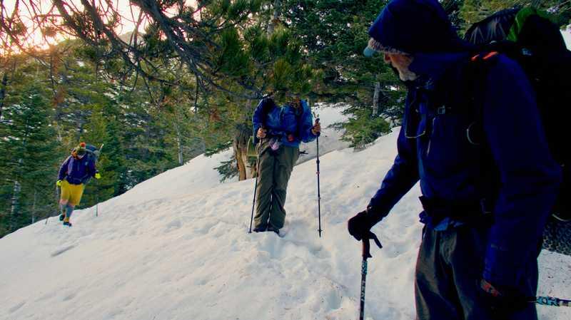 Crossing bad, snowy slope