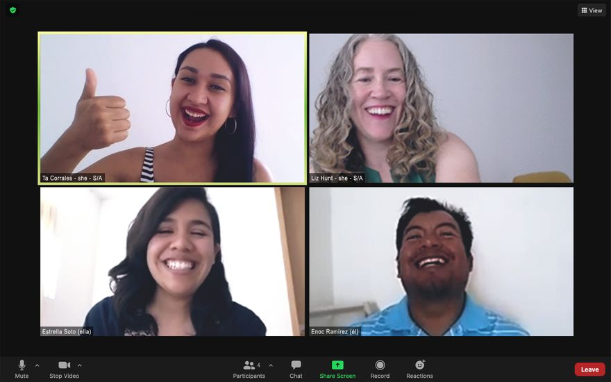 a screenshot of a zoom call in which the four participants are laughing