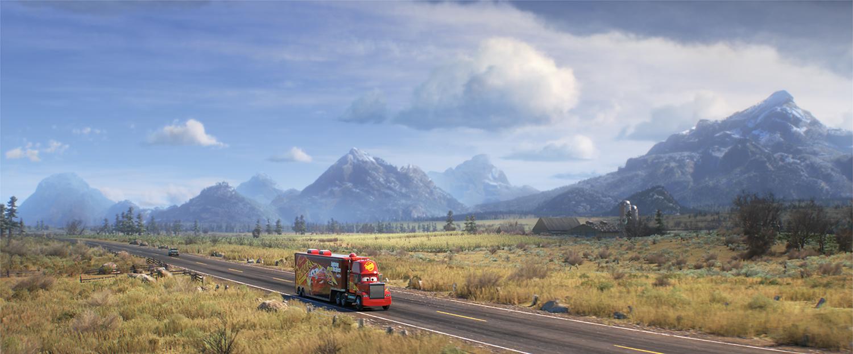 Um caminhão atravessa uma planície.