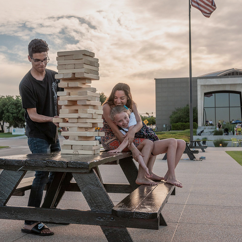 family playing giant jenga