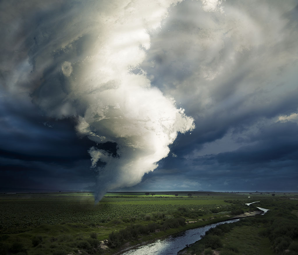 A tornado is a violently rotating column of air that is in contact with both the earth and the clouds.