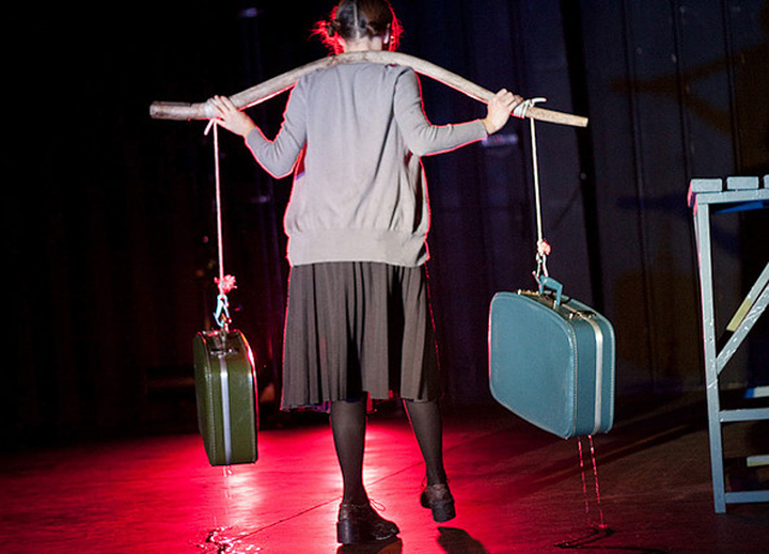 She's walking away with the yoke, water dripping from the cases