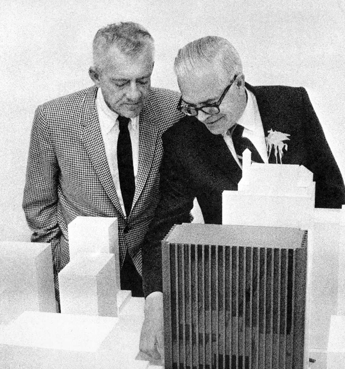 Black and white image of Howard K. Smith, HKS's founder, working on a design model on a table