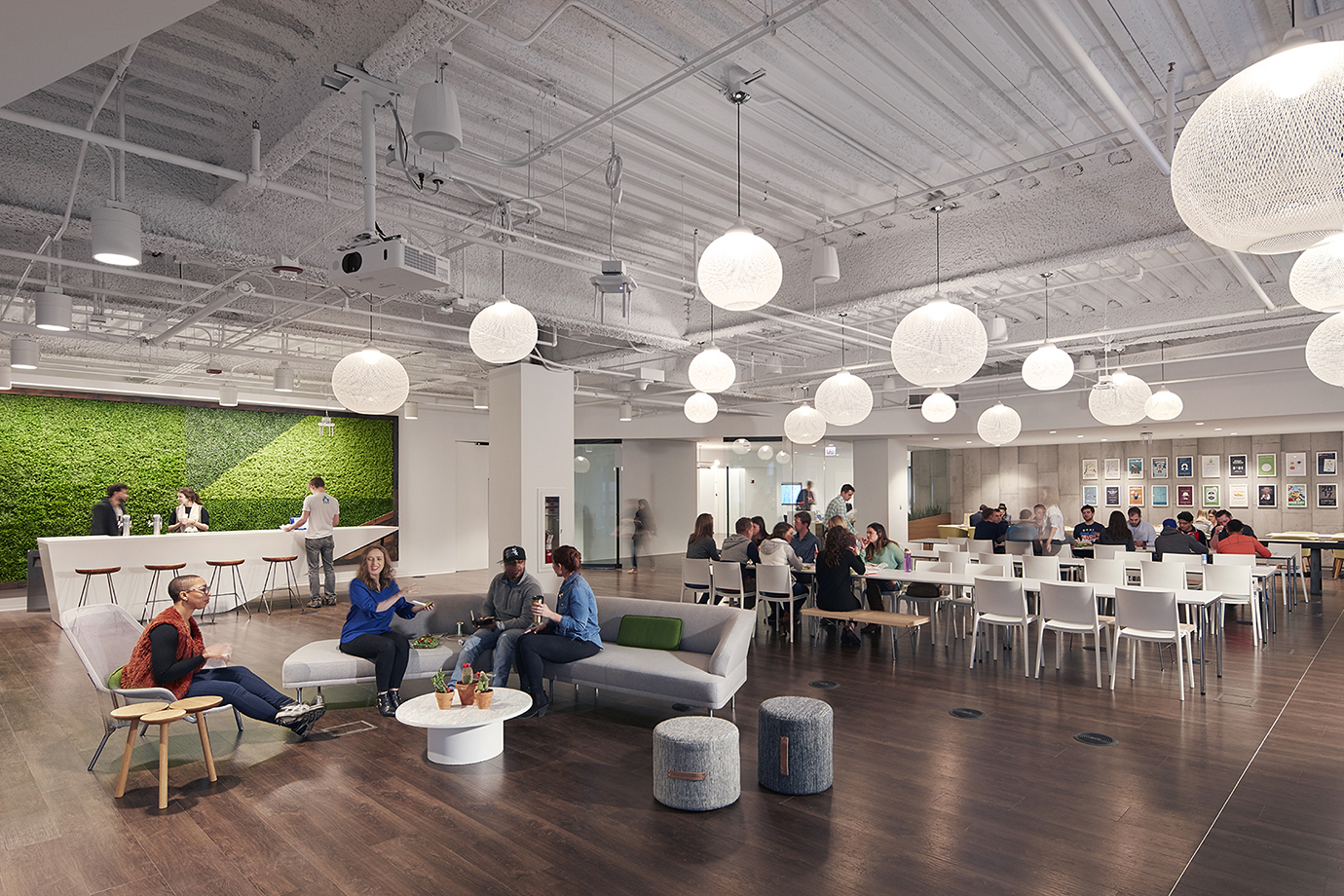 Many people in a large, open office space.