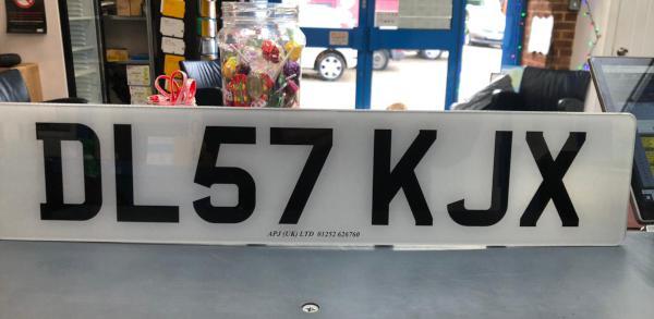 A standard plate that reads 'DL57 KJX'