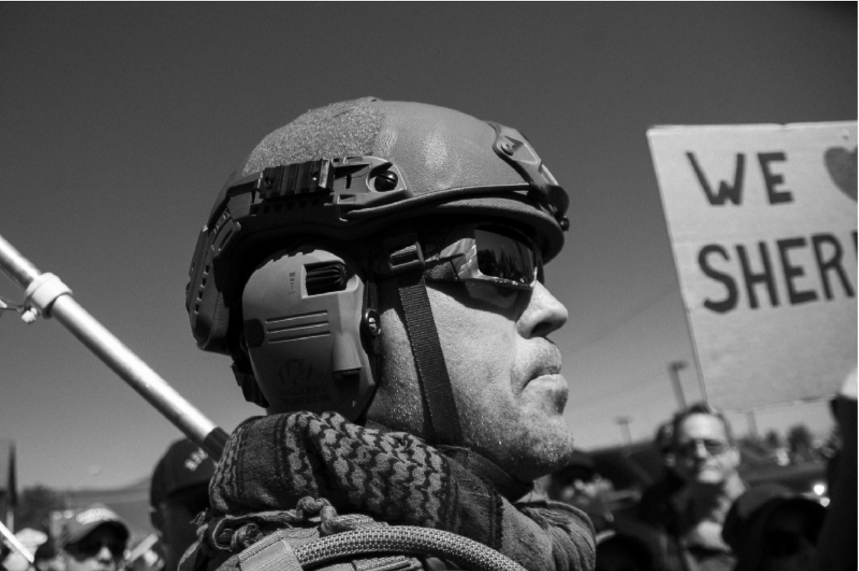 A member of a local militia provides crowd control for the Douglas County Sheriff at a Black Lives Matter Rally. Photo by JJ Mazzucotelli