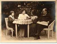 Emile Zola with his wife and two children Jacques and Denise sitting in the garden
