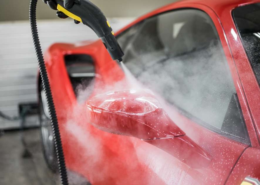 Paint protection film (PPF) being steamed on side mirror of Ferrari 458 GTB