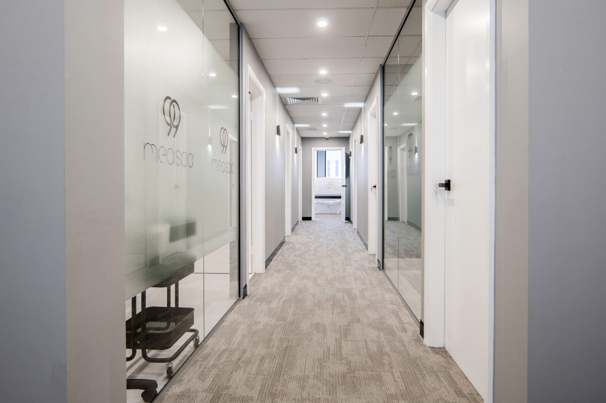 99 Medispa clinic corridor with glass walling