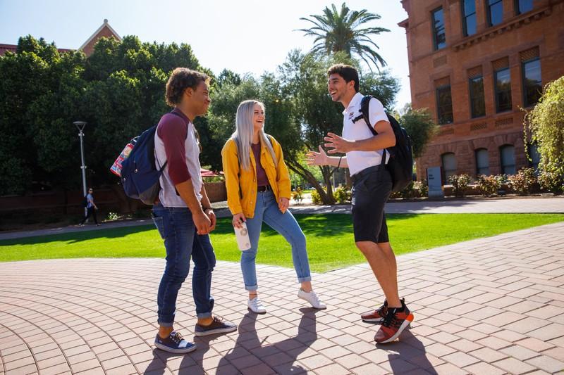 Arizona State University students talking on a quad