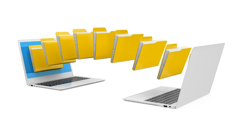 Image of files being transferred between two laptops.
