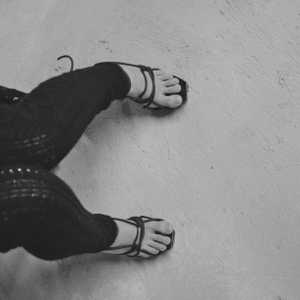 Hot woman in hight heels. Avant garde fashion. Haute de couture. Tribal postapocaliptic fashion. Foot fetish