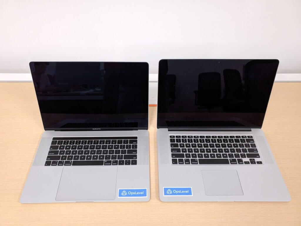 Left: MacBook Pro 2019 with touchbar and massive trackpad. Right: MacBook Pro 2015 with dedicated Escape key and non-flaky keyboard.