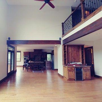 white room with dark brown pillars