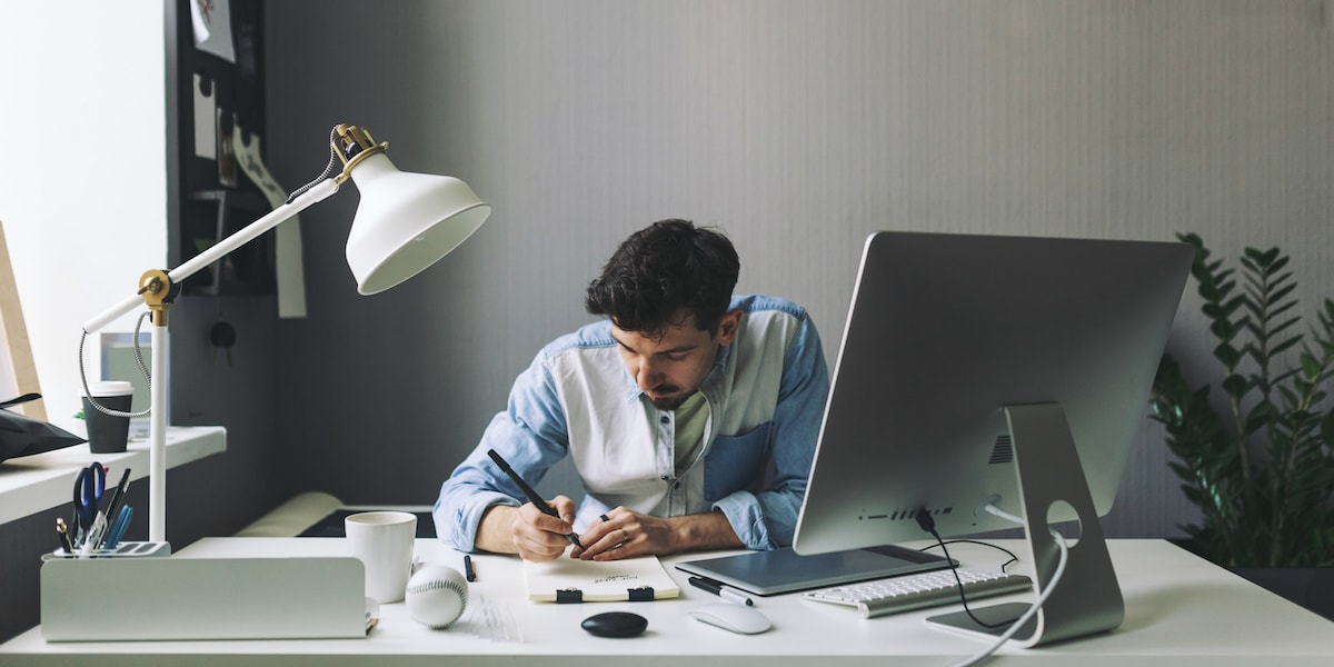 A full-stack web developer working at a computer