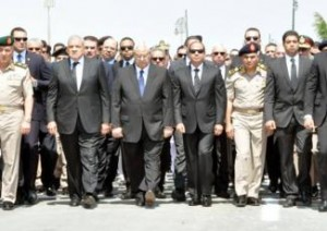 [President Abdel-Fattah Al-Sisi and government officials at the funeral of Prosecutor General Hisham Barakat who was killed in a car bomb attack on 29 June 2015. Source: Official Facebook Page of the Spokesperson of the Egyptian Armed Forces.]