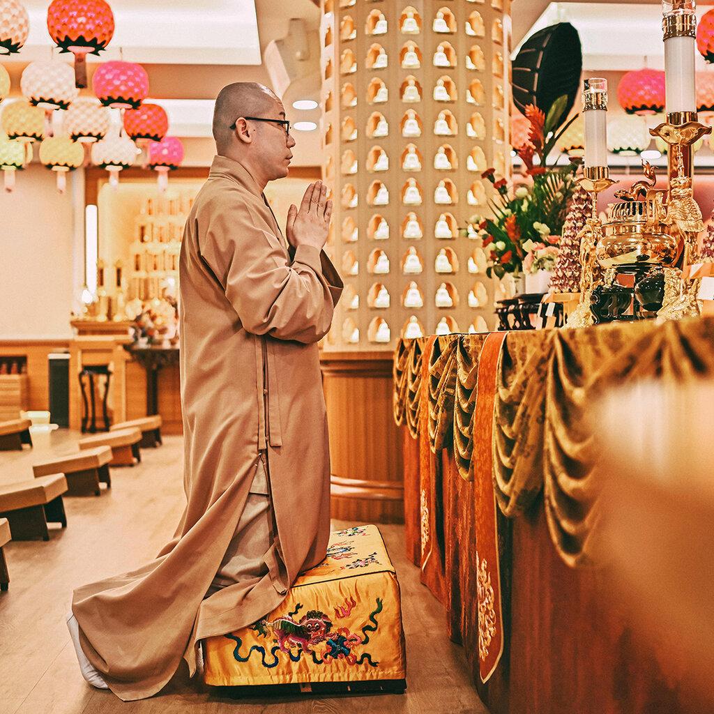 Buddhist monk praying