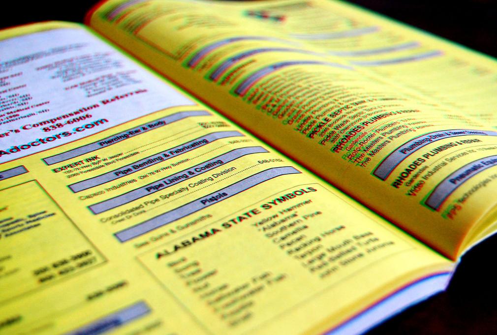 livro de páginas amarelas, com o efeito 3D de sempre
