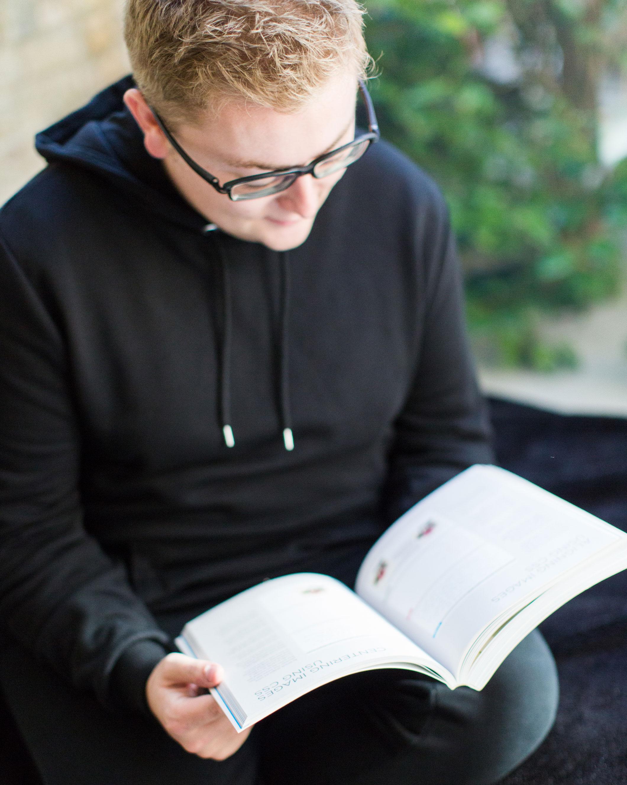 Jack Watkins sat in a window seat reading a book