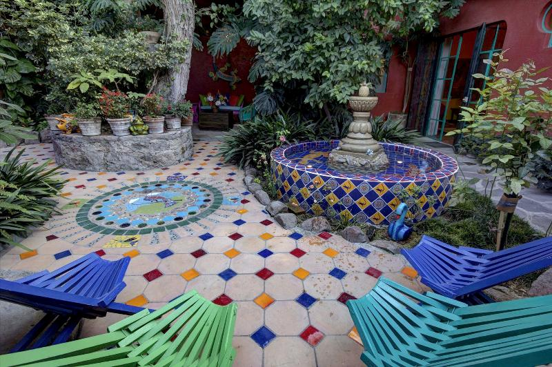 The hand made fountain and Hummingbird Mosaic in the patio add to prevailing tranquil mood.